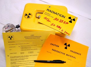 yellow metal box, source, isotope permit, warning panel